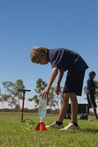 A Meekatharra DHS student carefully preparing their water rocket for launch