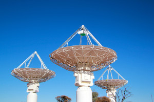 Three dish antennas of the Australian SKA Pathfinder constructed by CSIRO in Western Australia.
