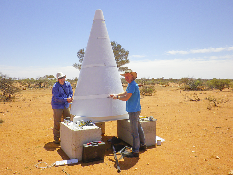 Dr Marcin Sokolowski and Dr Randall Wayth installing the BIGHORNS cone antenna at the Murchison Radio-astronomy Observatory.