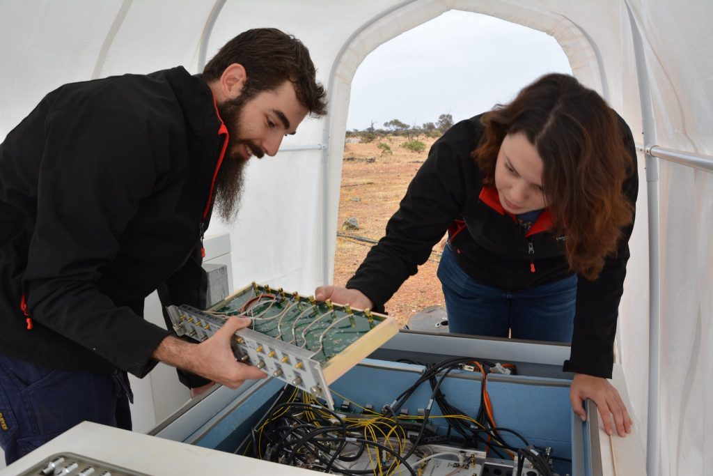 MWA Engineering Intern Mia Walker and Engineering Support Technician Luke Horsley making adjustments to an MWA receiver.