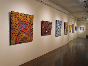 Paintings in the Ilgarijiri exhibition on display in Geraldton.
