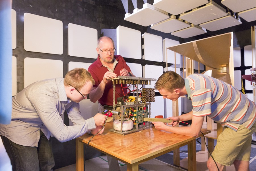 ICRAR PhD Candidate James Buchan, Lawrence Borle from ICRAR Industry partner Balance Utility Solutions and Tom van Nunen, ICRAR engineering intern from the Netherlands prepare a power supply destined for inclusion in the SKA-Low verification platform.