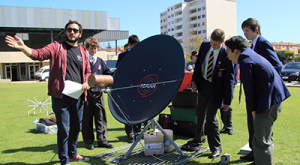 ICRAR PhD Candidate Mehmet Alpaslan explains the Tiny Radio Telescope (TRT) to students during an incursion to Christ Church Grammar School.