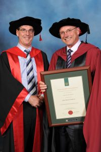 Dr John O'Sullivan (right) and Professor Peter Hall at the ceremony in September. Credit: Image provided by Curtin University