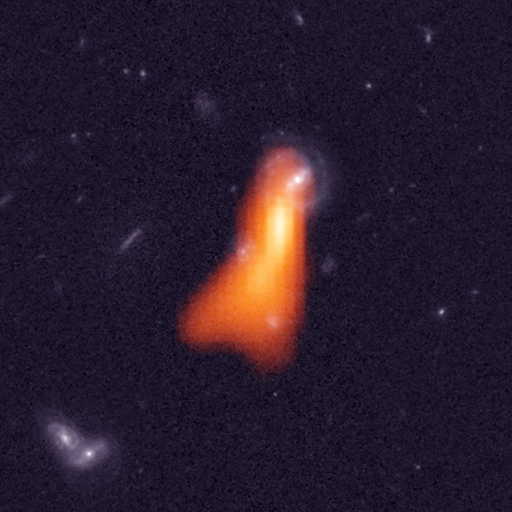 Hubble Space Telescope image of the galaxy with overlay of the hydrogen emission that was recently discovered. Credit: Fernández et al, NRAO/AUI/NSF, NASA