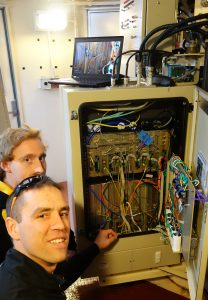 David Gozzard and Sascha Schediwy inspecting the modifications to the Compact Array receivers. Credit Jock McFee.