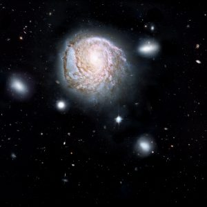This artist's impression shows the spiral galaxy NGC 4921 based on observations made by the Hubble Space Telescope. Credit: ICRAR, NASA, ESA, the Hubble Heritage Team (STScI/AURA)