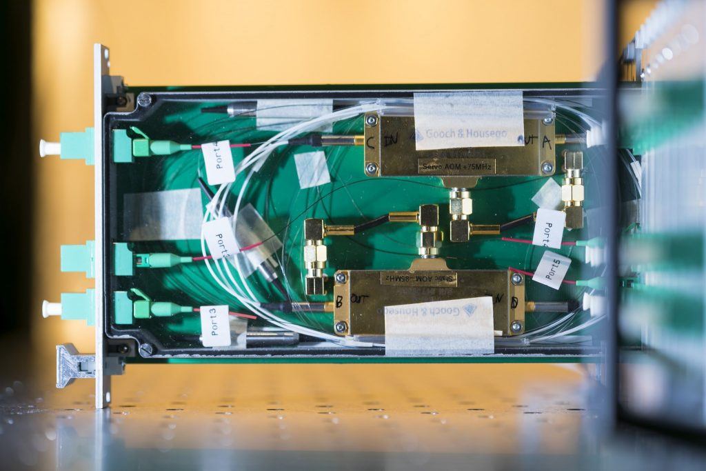 A prototype Transmitter Module shown partly extended from the front of a Sub-Rack enclosure, revealing details of the system's critical fibre-optic components. Credit: ICRAR.