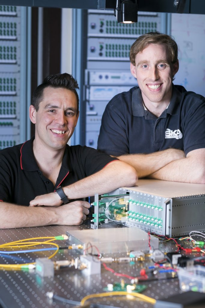 Sascha Schediwy and David Gozzard with a prototype of their SKA-mid Transmitter Module and Sub-Rack enclosure. Credit: ICRAR.