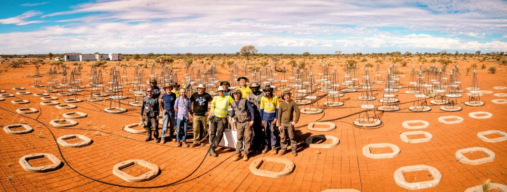 Members of ICRAR's Engineering team working with colleagues from the National Institute for Astrophysics in Italy to install antennas for the Aperture Array Verification System Test Platform. Credit: ICRAR