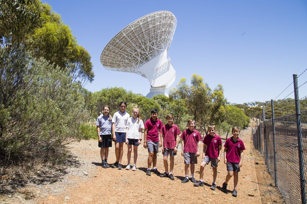 Current and ex Dalkeith Primary School students with the European Space Agency 35m tracking dish in New Norcia. The dish has just started tracking Proxima Centauri in preparation to send the students' message to our nearest stellar neighbour.
