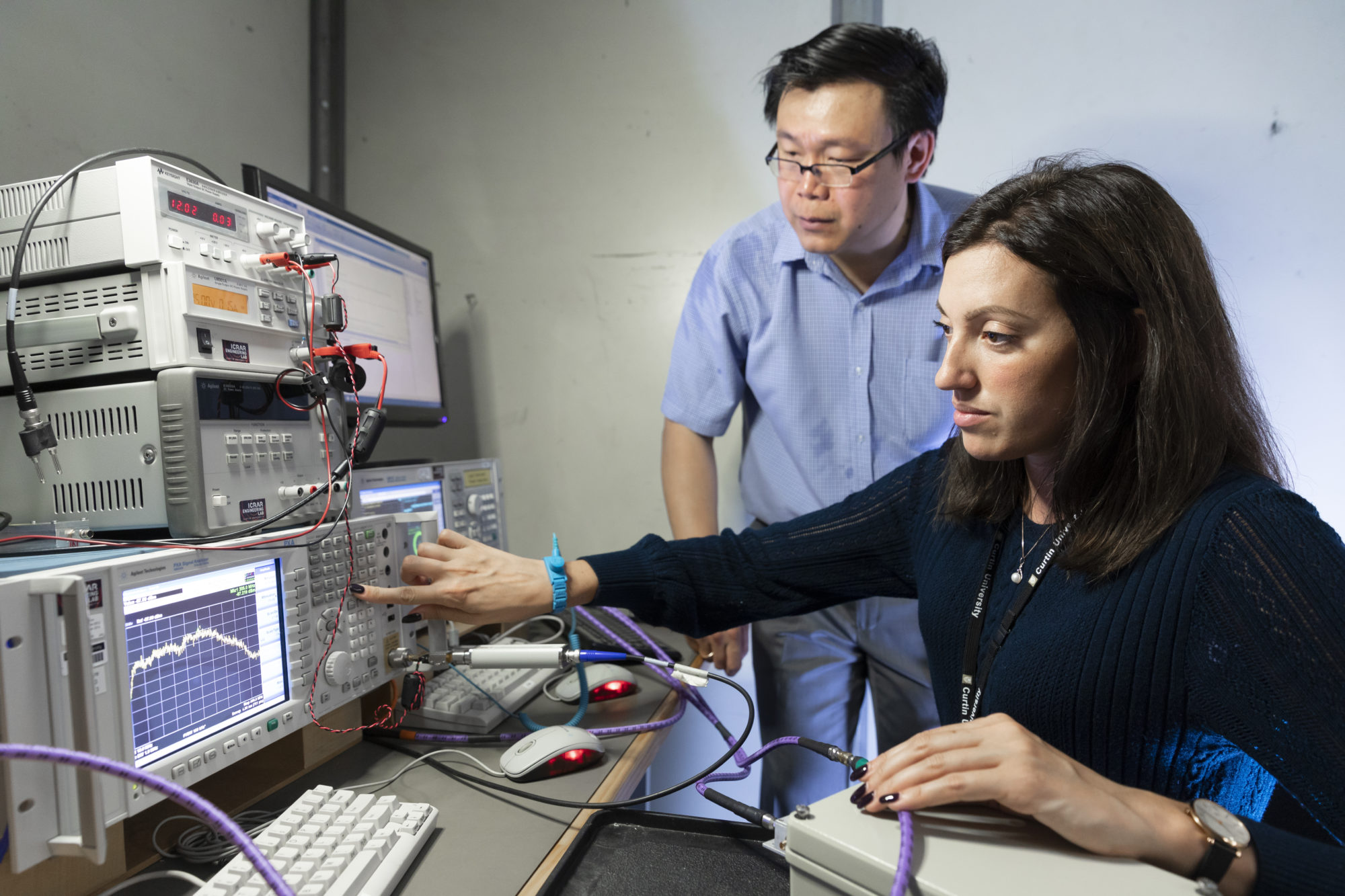 Dr Maria Kovaleva and Dr Budi Juswardy characterising a radio frequency device in our RF laboratory.