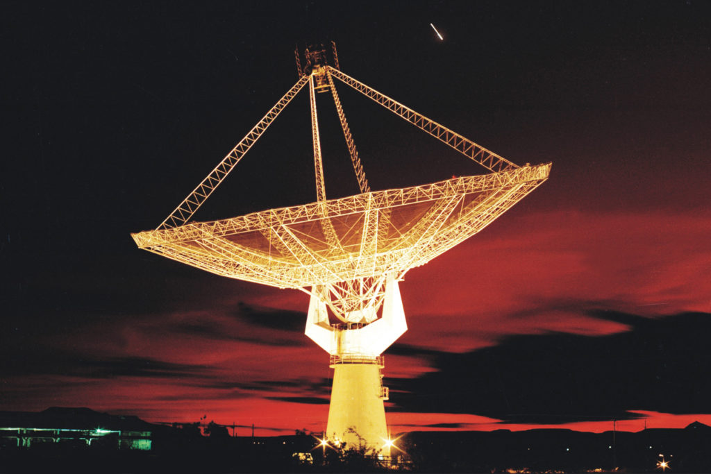A view of a GMRT antenna lit up at night