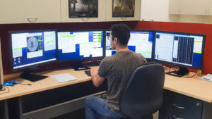 ICRAR PhD Candidate Hosein Hashemizadeh in the remote observing control room setting up for observing with the Anglo-Australian Telescope.