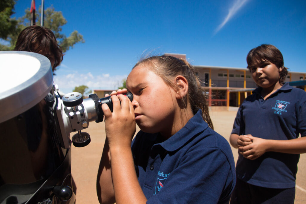 Students at Meekatharra DHS observing the Sun through one of ICRAR's outreach telescopes during a tour of schools and communities in the Mid West.