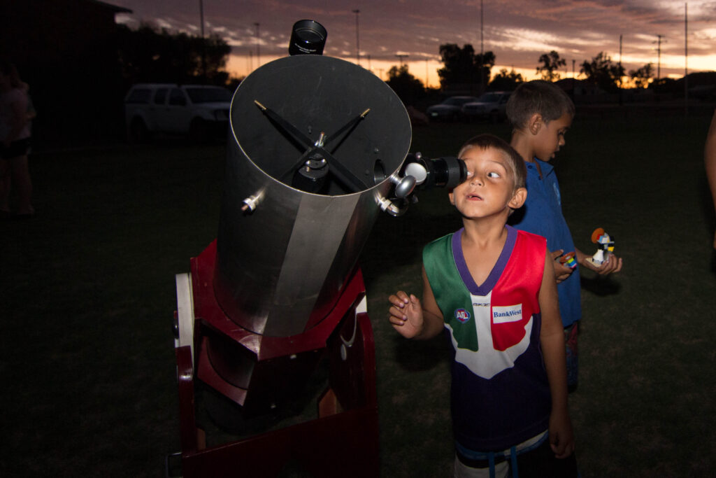 A young mind exploring the sky above at one of ICRAR's community events.